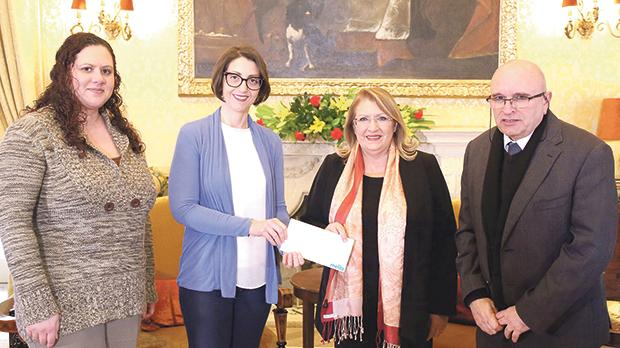 Mireille Muscat presenting the donation to President Marie-Louise Coleiro Preca.