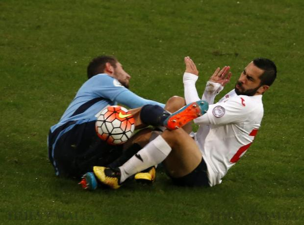 Sliema Wanderers' Peter Xuereb (left) and Valletta's Leandro Aguirre collide during during their Premier League football match at the National Stadium in Ta' Qali on November 19. Photo: Darrin Zammit Lupi
