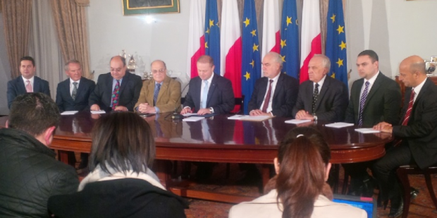 Dr Muscat speaks on the new citizenship scheme with, from left Parliamentary Secretary Edward Zammit Lewis, former MHRA president Tony Zahra in his personal capacity, minister Manuel Mallia, MFSA chairman Joe Bannister, minister Louis Grech, David Curmi, president of the Chamber of commerce, Parliamentary Secretary Owen Bonnici and Kenneth Farrugia, chairman of Finance Malta