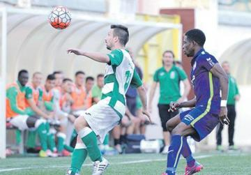 In control... Floriana's Maurizio Vella (left) gets to the ball ahead of St Andrews' Felix Udoh. Floriana beat the Saints 4-1. Photo: Steve Zammit Lupi