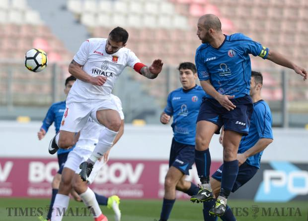 Valletta's Steve Borg (left), heads the ball into the net to score a goal despite bring marked by Zejtun's Yessous Camilleri's during the FA trophy match at the National Stadium in Ta'Qali on February 17. Photo: Matthew Mirabelli