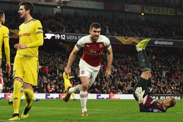 Arsenal's Greek defender Sokratis Papastathopoulos (C) celebrates after scoring their third goal.