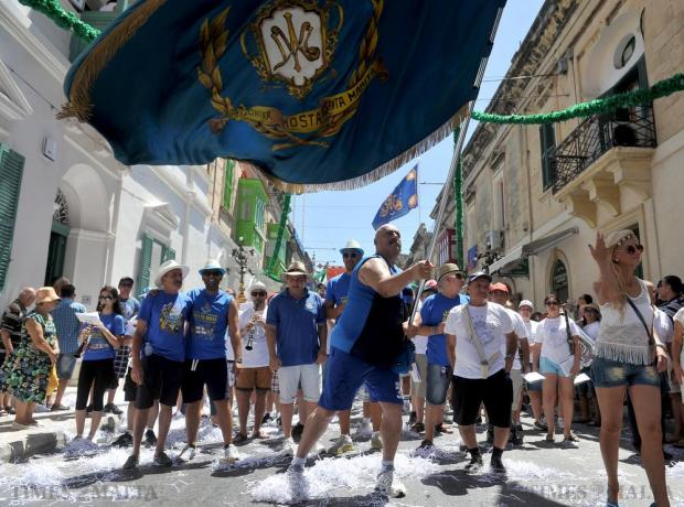 A man waves a flag at the march at the Santa Marija Feast in Mosta on August 15. Photo: Chris Sant Fournier