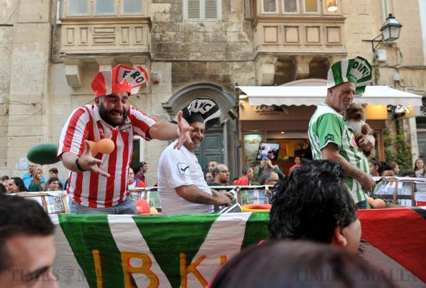 Supporters of Premier League champions Valletta, wearing kits of rival teams, participate in a mock funeral to celebrate the demise of their rivals on May 6. Photo: Chris Sant Fournier