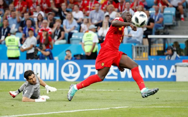 Belgium's Romelu Lukaku scores their third goal.