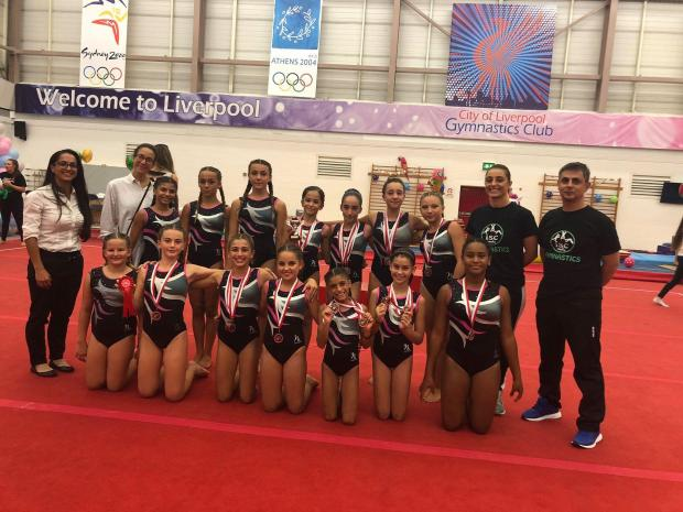 The gymnasts showing off their medals in Liverpool.