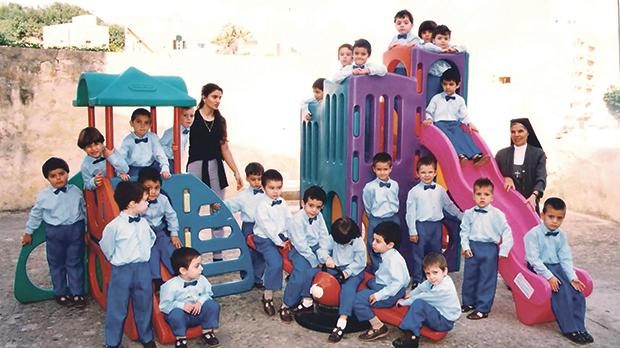 Sr Salvina Maria Curmi with her class of boys at Birżebbuga Kindergarten School.