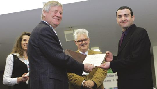Jurgen Schmid (left) President of the European Academy of Wind Energy, presenting the award to Tonio Sant.
