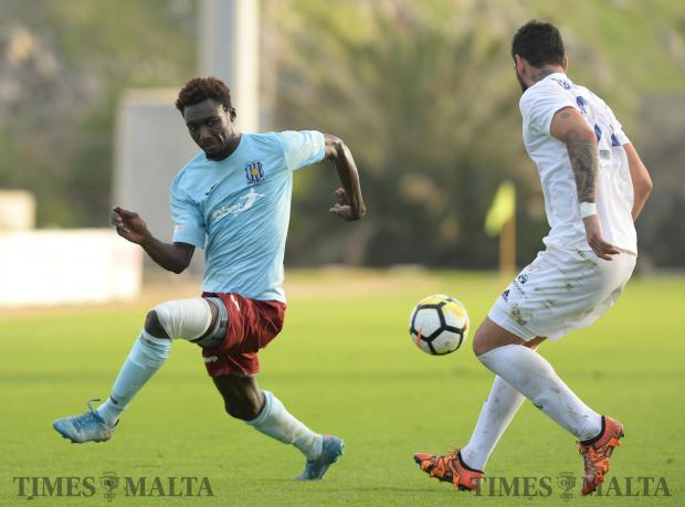 Gzira's Amadou Samb, (left) tries to make his way past Goran Adamovic (right) during their BOV Premiership match at The Hibernian's Stadium in Paola on November 25. Photo: Matthew Mirabelli