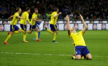 Sweden's Sebastian Larsson and team mates celebrate after the match.