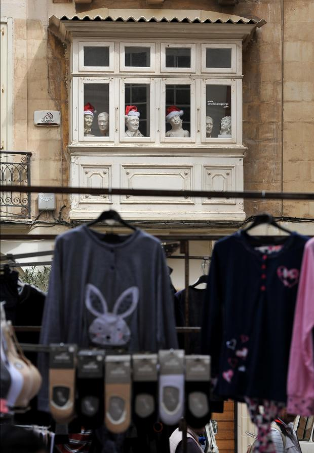 Mannequins watch the comings and goings at the Valletta market on March 14. Photo: Chis Sant Fournier