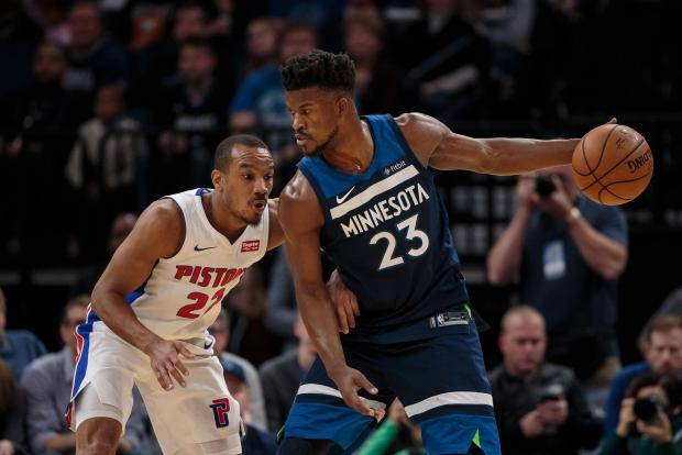 Minnesota Timberwolves forward Jimmy Butler (23) dribbles in the first quarter against the Detroit Pistons guard Avery Bradley (22) at Target Center. Photo: Brad Rempel-USA TODAY Sports
