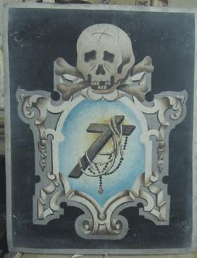 Death symbols on the placards accompanying the tubru – an empty coffin set up in church.