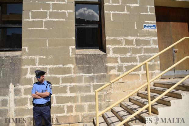 A police man guards the entrance to backstage were a debate was being held between the main Political leaders held at the University of Malta on May 17. Photo: Mark Zammit Cordina