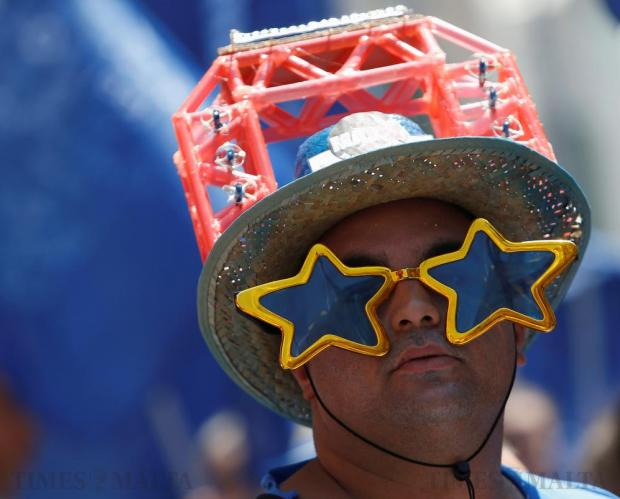 A reveller takes part in a village band march during celebrations marking the feast of the Assumption of Our Lady in Mosta, on August 15. Photo: Darrin Zammit Lupi