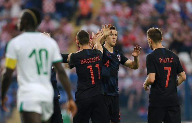 Croatia's Ivan Perisic celebrates scoring their first goal with teammates.