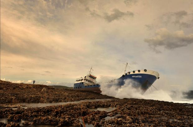 A man watches the ill-fated tanker The Hephaestus, which ran aground in Qawra after breaking its moorings on February 10. Photo: Chris Sant Fournier