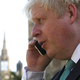 London mayor Boris Johnson speaking on the phone yesterday as he gathered with other MPs who oppose the expansion of Heathrow airport. Photo: Paul Hackett/Reuters