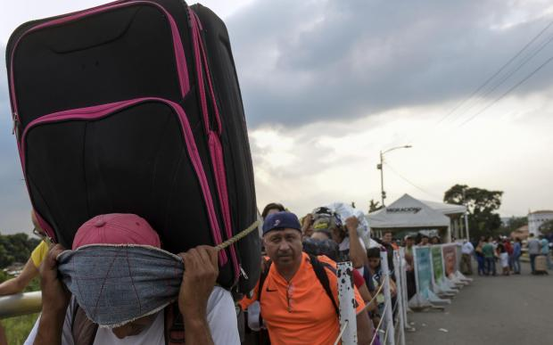 People cross on the border between Tachira in Venezuela and Cucuta in Colombia. Over 3 million people have already left.