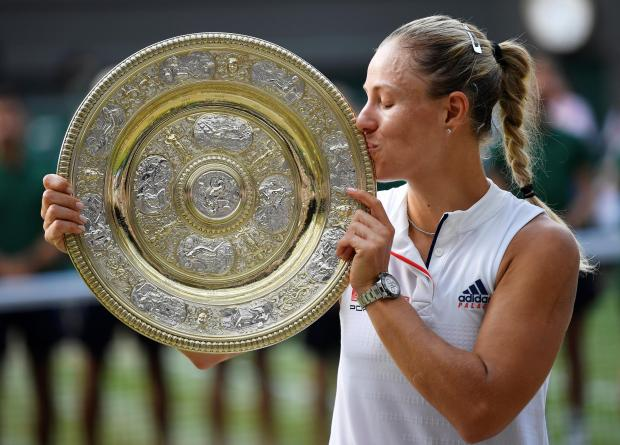 Angelique Kerber kisses the trophy after defeating Serena Williams.