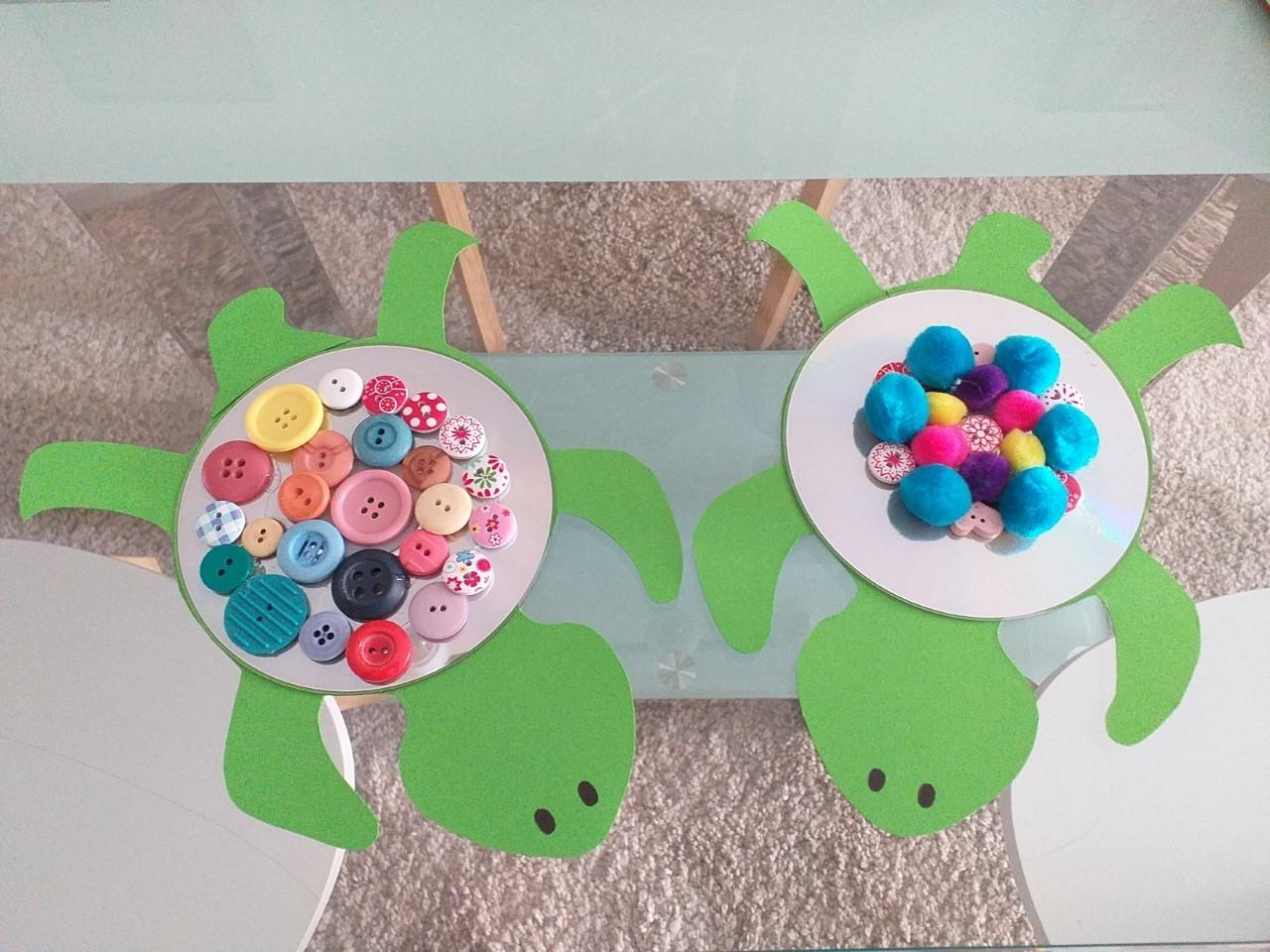 Mae (8) and Ella (3) used colourful buttons to make sure their crafts stand out.