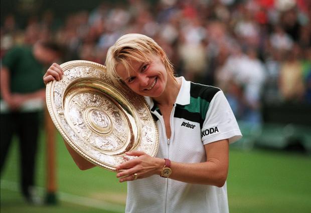 Jana Novotna won the Wimbledon title after defeating Nathalie Tauziat in 1998.