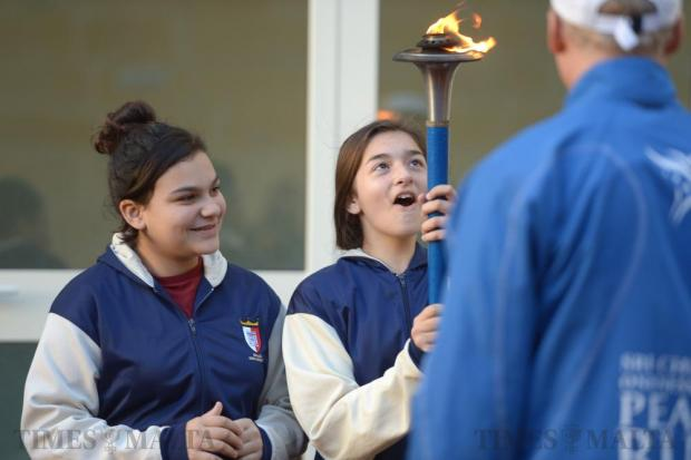 Students from St Margaret Middle School in Cospicua pass on the Peace Torch to each after runners from the Sri Chinmoy Oneness-Home Peace Run visited the school on January 11. Photo: Matthew Mirabelli