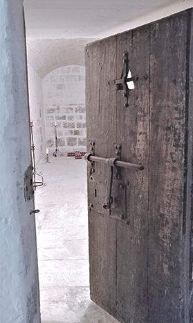 The interior of a prison cell in the Castellania.