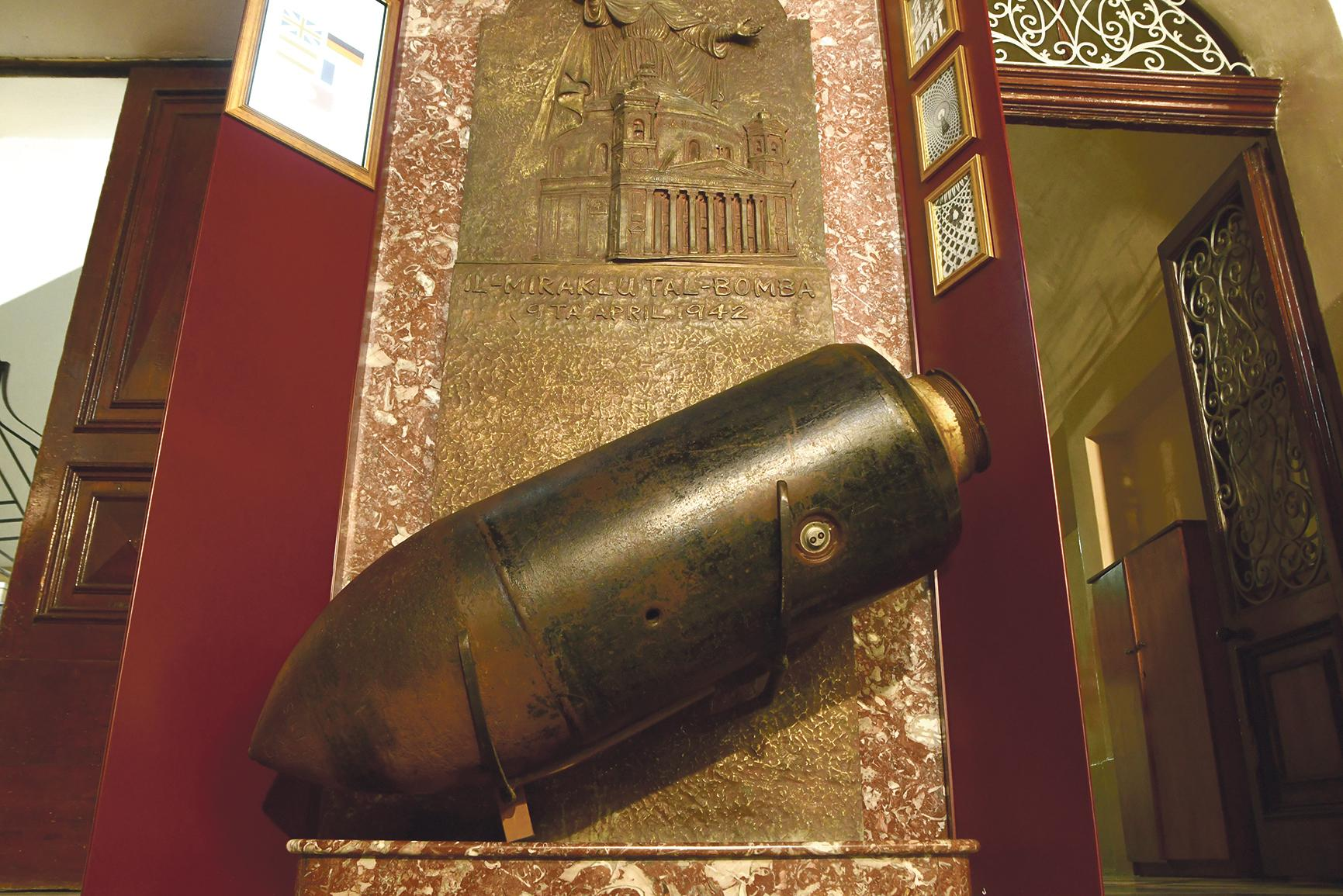 A replica of the bomb that hit the rotunda on April 9, 1942, without detonating, is found in the church's museum.