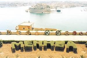 Going round: Gabriel Caruana`s set of circular paintings at the old saluting battery at the Upper Barrakka Gardens in Valletta. Picture: Alfred Giglio.