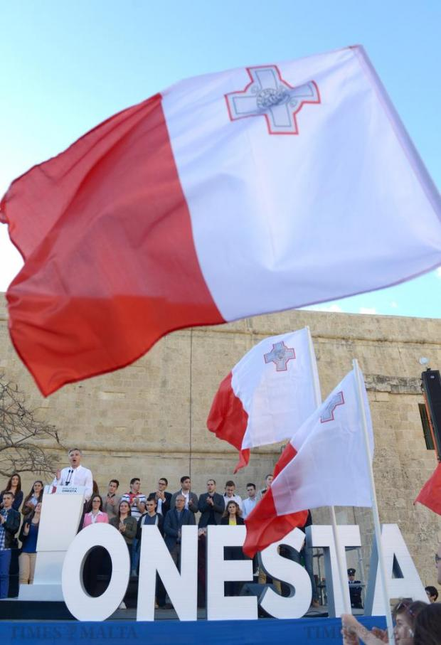 Opposition leader Simon Busutill delivers his address during a demonstration calling for the resignation of the Prime Minister and two members of the government following the Panama Papers leak scandal outside Castille in Valletta on April 10. Photo: Matthew Mirabelli