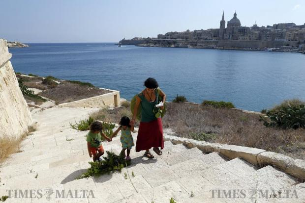 An activist and her children walk close to the foreshore of Manoel Island in Gzira on September 10. The activists of Kamp Emergenza Ambjent, a coalition of green groups, entered an area of the island that had been blocked off for 16 years by Midi, a company with a concession on the island. Photo: Darrin Zammit Lupi
