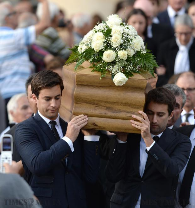 The sons of murdered blogger Daphne Caruana Galizia, Matthew (right) and Andrew (left). carry the coffin of their mother out of the church in Mosta, on November 3, after her funeral ceremony. Photo: Matthew Mirabelli