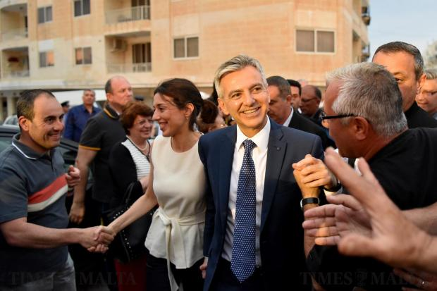 Nationalist Party and opposition leader Simon Busuttil is greeted by a crowd upon entering a political event in St Paul's Bay on May 17. Photo: Mark Zammit Cordina