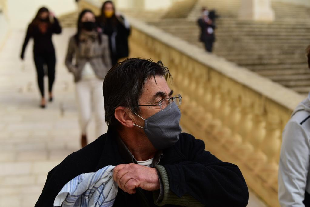 Joseph Cini waves a handkerchief as he exits court on Wednesday. Photo: Mark Zammit Cordina