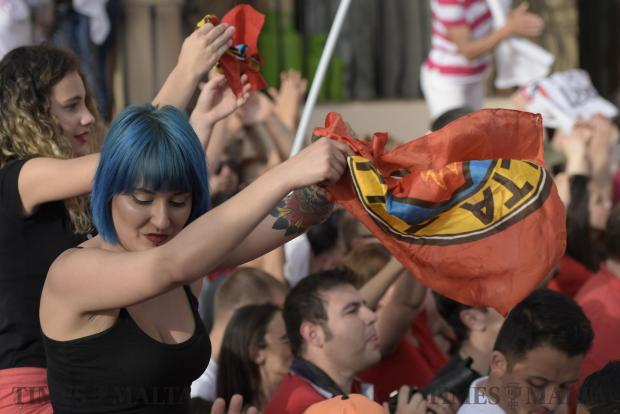A woman with blue dyed hair waves her Labour party scarf during a meeting held by the Labour party in Zabbar on May 7. Photo: Mark Zammit Cordina