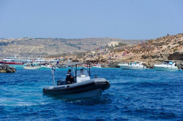 A police boat patrols the sea off the shore Comino on August 17. Photo: Steve Zammit Lupi
