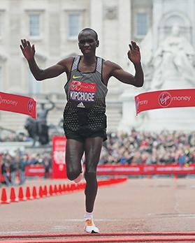 Eliud Kipchoge crosses the finish line at the London Marathon.