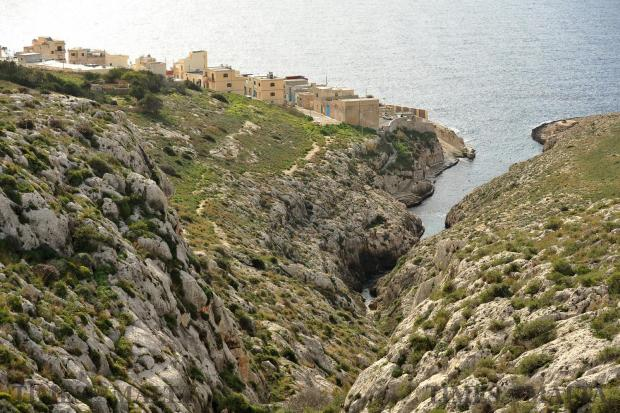 The shimmering sea and green-washed garigue provide the perfect backdrop for the hamlet perched on the cliff side at Wied iz-Zurrieq on January 25. Photo: Chris Sant Fournier