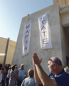 The banners reading 'Mafia state' hanging at Freedom Square.