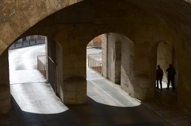 A couple walks through Victoria Gate in Valletta on December 27. Photo: Matthew Mirabelli