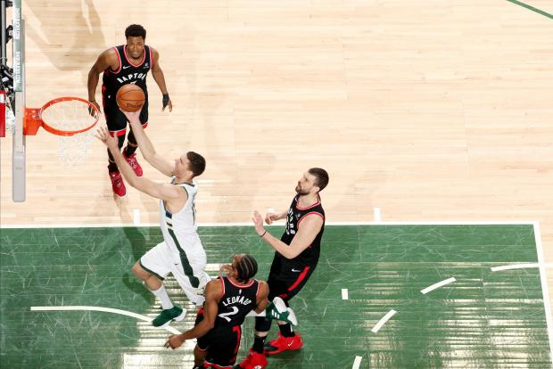 Brook Lopez #11 of the Milwaukee Bucks shoots the ball against the Toronto Raptors.