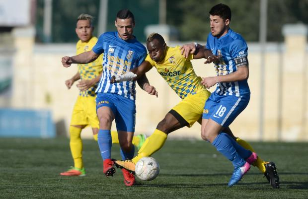 San Gwann (yellow) brushed aside Pieta to close in on a promotion berth during their BOV Division One league match at the Tedesco Stadium in Hamrun on March 11. Photo: Matthew Mirabelli