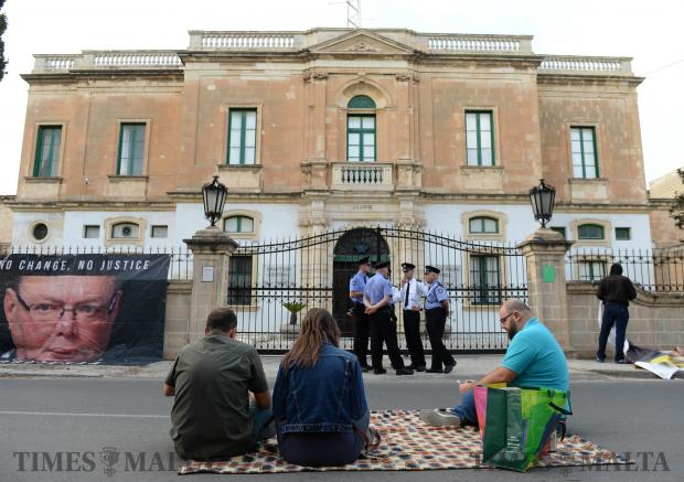 People make themselves comfortable during the second sit-in protest organised by the Civil Society Network in front of the Police HQ on November 5 in Floriana. The protestors called for the resignation of the Police Commissioner and the Attorney General. Photo: Matthew Mirabelli