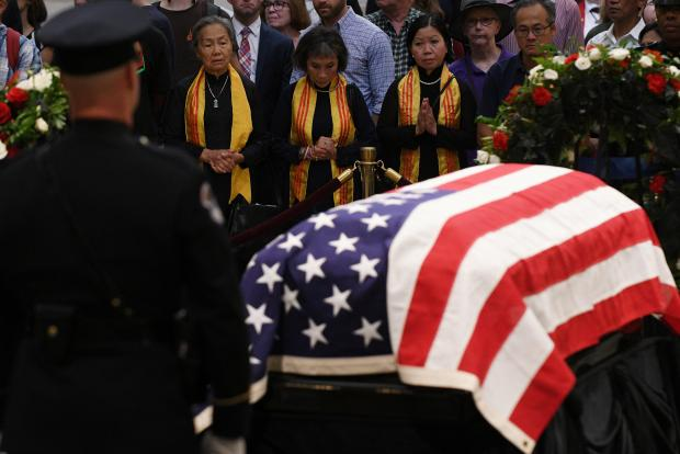 Mourners file past the casket of Senator McCain who lies in state in the Rotunda at the US Capitol in Washington.