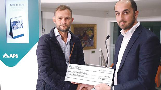 Mr Borg (left) being presented with his prize by Jeffrey Cassar, one of the competition judges.