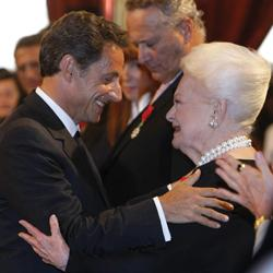 French President Nicolas Sarkozy with Japan-born British actress Olivia de Havilland, after she was awarded the Knight of the Legion of Honour, at the Elysee Palace in Paris. Photo: Jacques Brinon/AP
