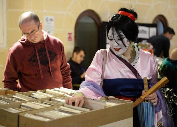 A lady in costume browses through some comics during the 2017 Comic Con at The Mediterranean Conference Centre in Valletta on December 3. Photo: Matthew Mirabelli