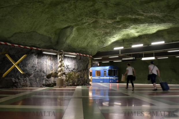 Artwork is displayed on exposed rock at an underground Metro station in Stockholm on May 11. Photo: Mark Zammit Cordina