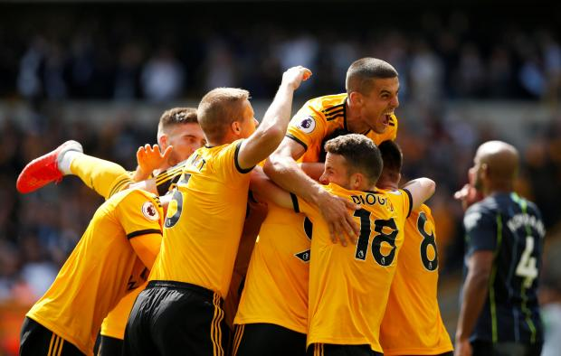 Wolves players celebrate their goal against Manchester City.